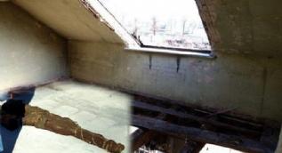 Evin çatısında bulduğu silah şoke etti